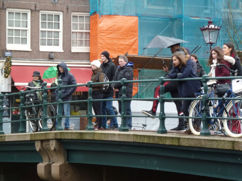 Locals and tourists watching the canals getting cleaned.